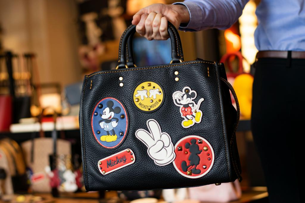 97bdbffbcb Disney Classics Featured on New Coach and Dooney and Bourke ...