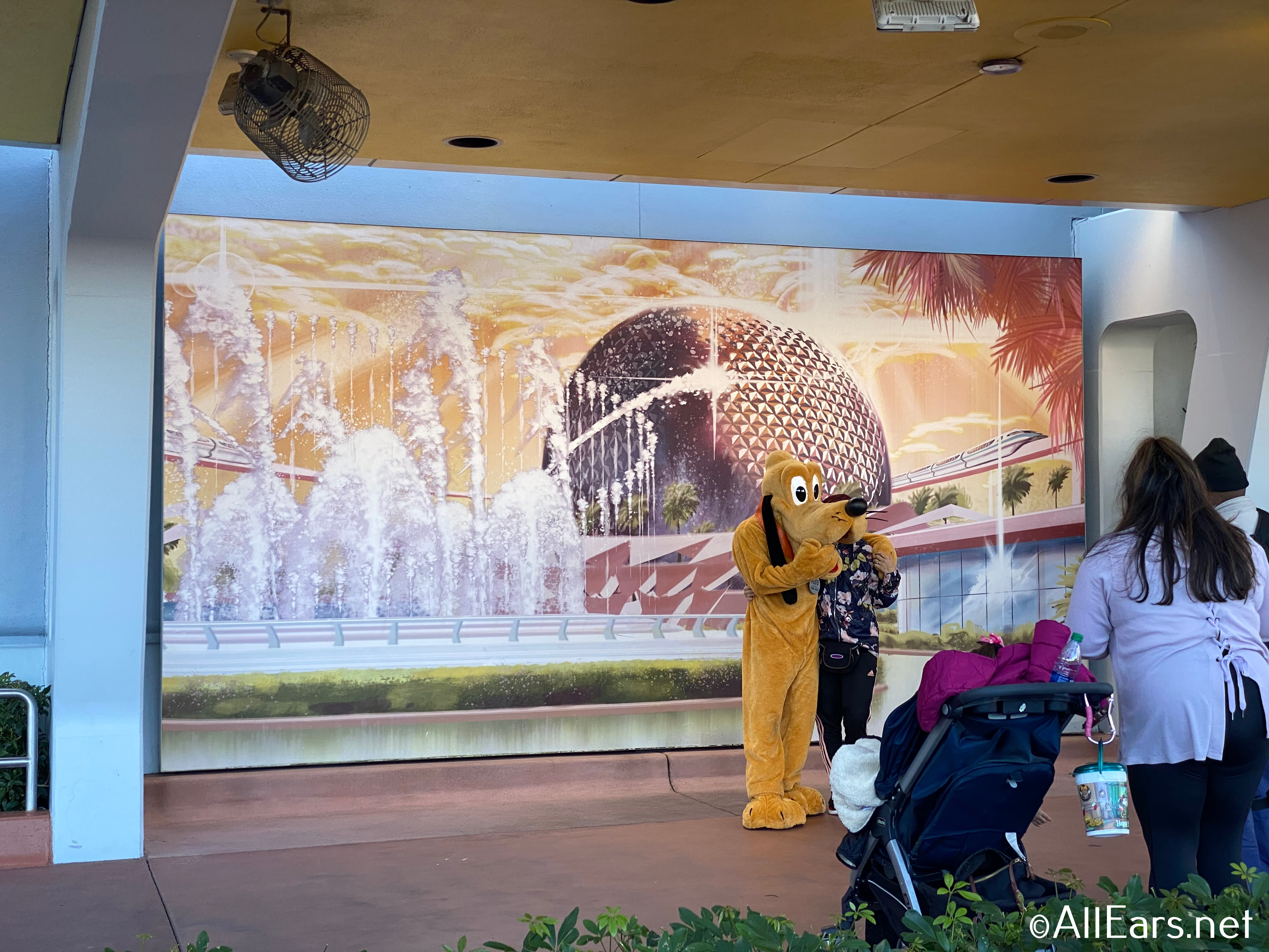 Pluto meeting at Epcot's front entrance