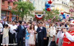 Walt Disney World Ambassadors escort the new citizens down Main Street USA.<br />