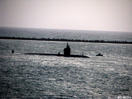 Submarine Surfaces just outside the Canal