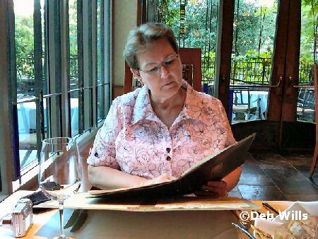 Linda looks over menu