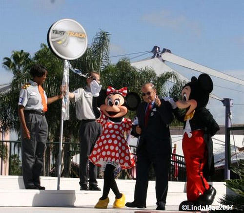 Marty Sklar escorted by Mickey and Minnie