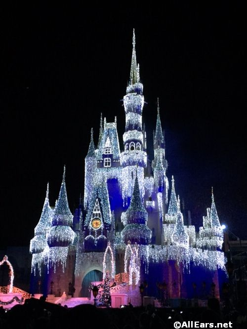 cinderella castle covered in ice for the holiday season - Disney World Christmas Decorations 2017