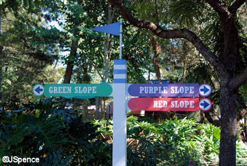 Red, Green, and Purple Sign Post