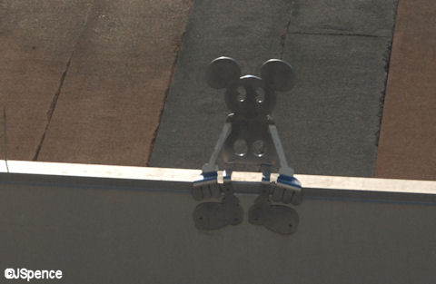Mickey Sitting on the Edge of a Building