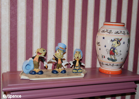 Pinocchio Pieces Above the Toilet