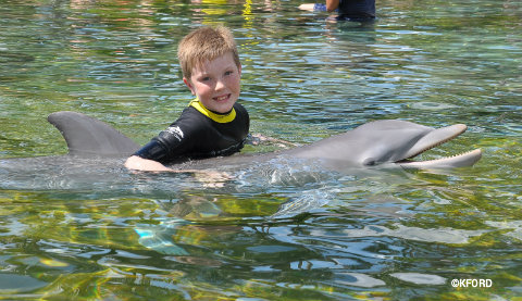 discovery-cove-carter-and-dolphin.jpg