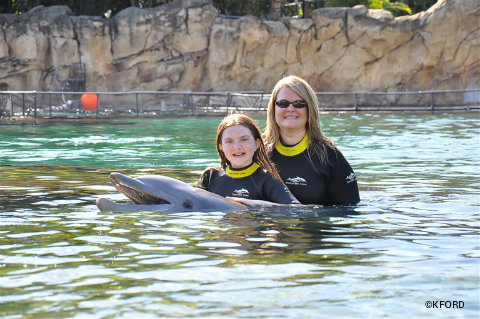 discovery-cove-kristin-lauren-with-dolphin.jpg