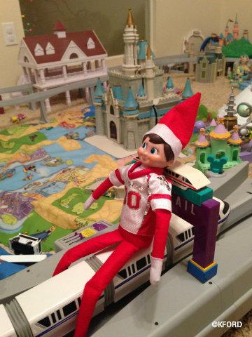 elf-on-the-shelf-disney-riding-monorail.jpg