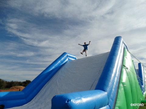 insane-inflatable-5k-carter-jumping.jpg