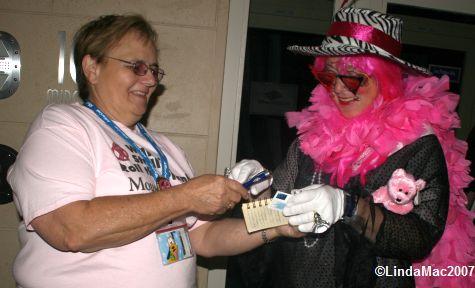 Ann Freeman gets Miss Dee Vah's autograph