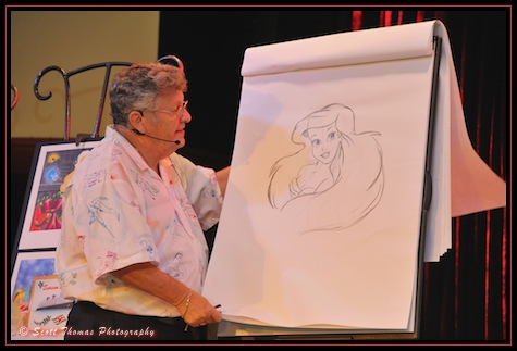 Don Ducky Williams finishing up a character portrait in the Odyssey restaurant in Epcot, Walt Disney World, Orlando, Florida