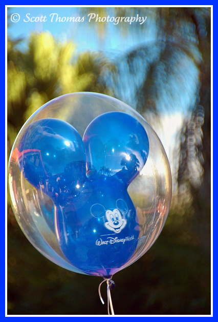 A blue Mickey Mouse balloon in the Magic Kingdom, Walt Disney World, Orlando, Florida