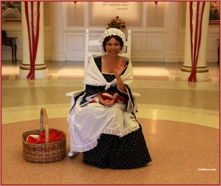 Here are 2 photos featuring Betsy Ross and her rocking chair in the  American Adventure Rotunda.