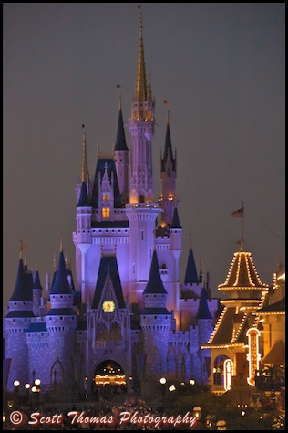 Cinderella Castle in blue as darkness falls over the Magic Kingdom, Walt Disney World, Orlando, Florida
