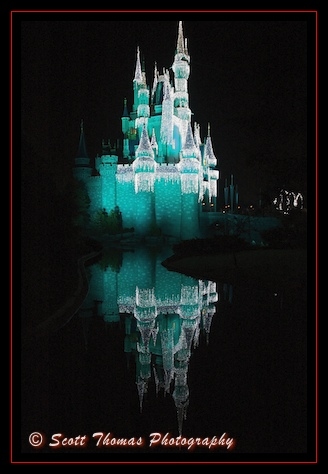 Cinderella Castle in Dream Lights over the Christmas holidays in the Magic Kingdom, Walt Disney World, Orlando, Florida