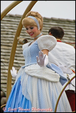 Cinderella waving to guests during the Celebrate a Dream Come True Parade in the Magic Kingdom, Walt Disney World, Orlando, Florida