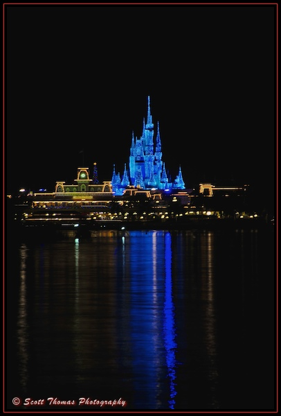 Cinderella Castle in holiday Dream Lights from the Ticket and Transportation Center, Walt Disney World, Orlando, Florida.