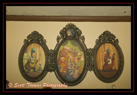 Country bear paintings hanging in Frontierland's Grizzly Hall in the Magic Kingdom, Walt Disney World, Orlando, Florida