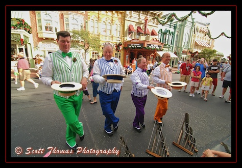 The Dapper Dans barbershop quartet entertain guests along Main Street USA in the Magic Kingdom, Walt Disney World, Orlando, Florida