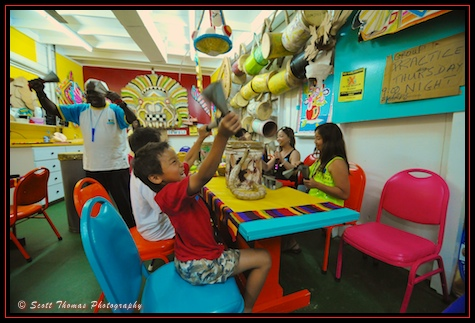 Ringing the cow bells at the Junkanoo museum inside the Ivern House on the Nassau Forts and Junkanoo Discovery Disney Dream excursion while visiting Nassau in the Bahamas.