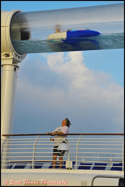 A guest rides the AquaDuck on the Disney Dream cruise ship.