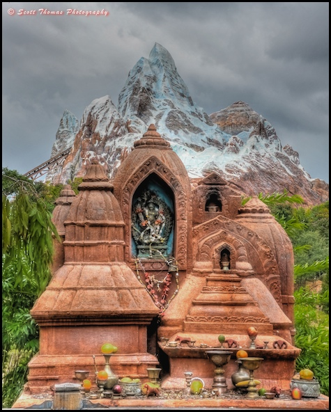Expedition EVEREST loams behind the Yeti Shrine in Disney's Animal Kingdom, Walt Disney World, Orlando, Florida.