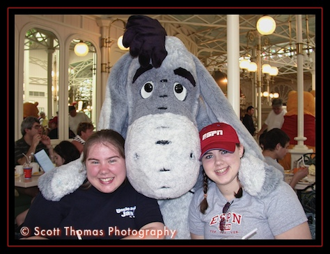 Snuggling up with Eeyore in the Magic Kingdom's Crystal Palace restaurant, Walt Disney World, Orlando, Florida