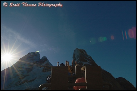 Sun near the summit of Everest in Disney's Animal Kingdom, Walt Disney World, Orlando, Florida.