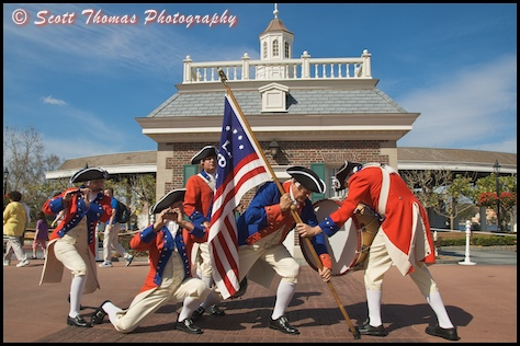 The Spirit of America Fife and Drum Corps performing outside the American Adventure in Epcot's World Showcase, Walt Disney World, Orlando, Florida.