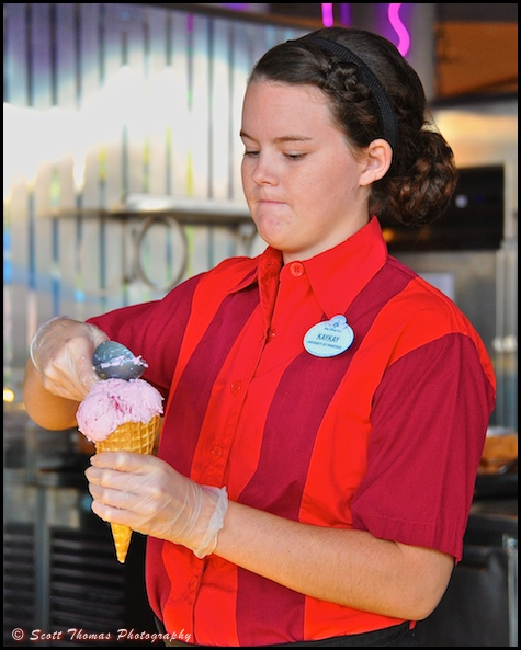 Fountainview Cafe Server making an ice cream cone in Epcot, Walt Disney World, Orlando, Florida.