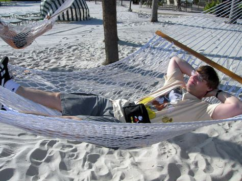 Picture This! blogger, Scott, relaxing in a hammock on the Polynesian Resort beach, Walt Disney World, Orlando, Florida
