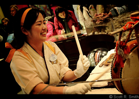 A Pick-A-Pearl Cast Member celebrates a guest finding a pearl in Japan's pavilion in Epcot's World Showcase, Walt Disney World, Orlando, Florida