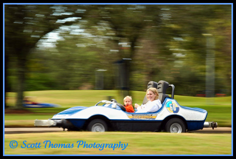 An Indy Car at speed in the Magic Kingdom, Walt Disney World, Orlando, Florida.
