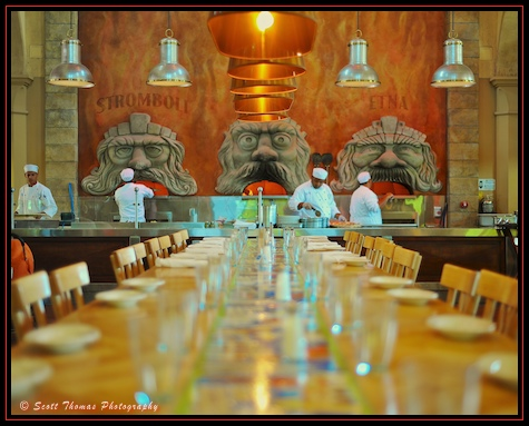 Chefs work to feed the three wood fired ovens at Via Napoli in Epcot's Italy pavilion, Walt Disney World, Orlando, Florida