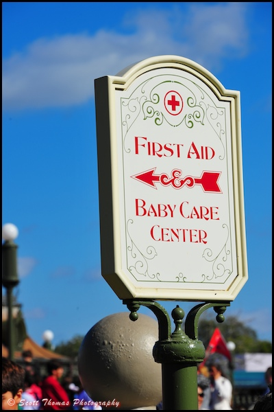 First Aid and Baby Care sign near the Crystal Palace restaurant in the Magic Kingdom, Orlando, Florida.