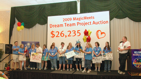 Dream Team Project Auction volunteers on stage at MagicMeets, Harrisburg, Pennsylvania.