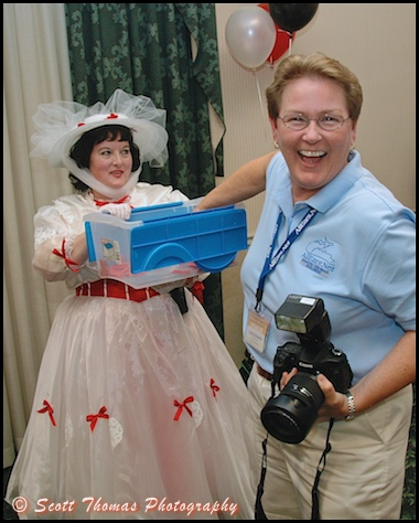 All Ears photographer Linda E pulls a lucky number with the help of Mary Poppins during the Meet before the Magic reception the night before MagicMeets, Harrisburg, Pennsylvania.