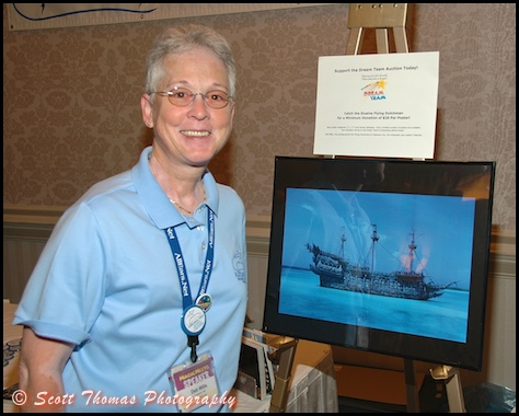 All Ears founder, Deb Wills, poses next to her poster of the Flying Dutchman before MagicMeets on Saturday, August 8, 2009, in Harrisburg, Pennsylvania.