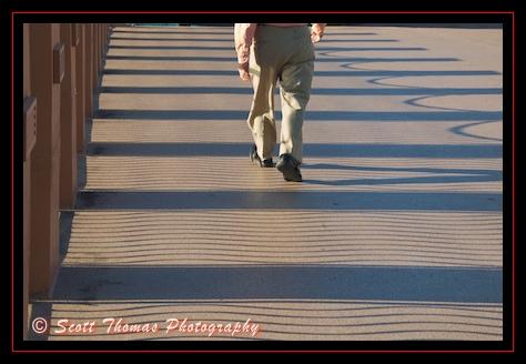 Walking over the pedestrian bridge from Disney's Boardwalk to the Swan Resort, Walt Disney World, Orlando, Florida