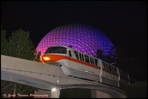 Monorail Orange passing Spaceship Earth at night in Epcot, Walt Disney World, Orlando, Florida.