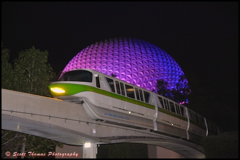 Monorail Green passing Spaceship Earth at night in Epcot, Walt Disney World, Orlando, Florida.