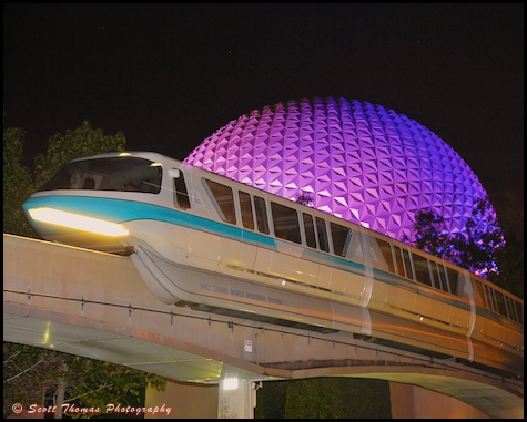 Monorail Blue passing Spaceship Earth at night in Epcot, Walt Disney World, Orlando, Florida.