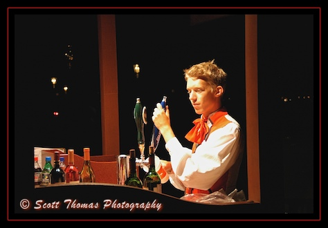 A Norwegian Cast Member pours some spirited beverages at Epcot's Norway Pavilion, Walt Disney World, Orlando, Florida