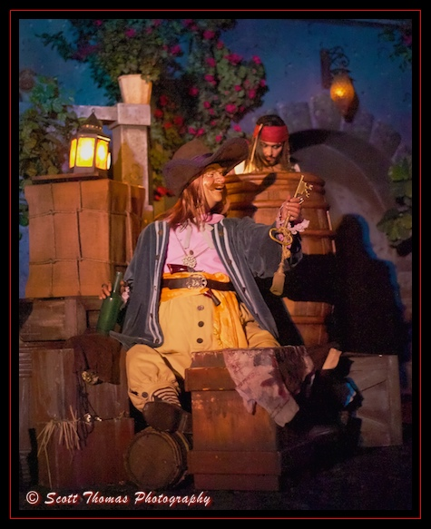 An audio-animatronic Captain Jack Sparrow eyes the key and treasure map of a drunken pirate in a scene from the Pirates of the Caribbean ride in the Magic Kingdom, Walt Disney World, Orlando, Florida