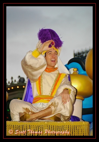 Aladdin waving to guests during a parade in the Magic Kingdom, Walt Disney World, Orlando, Florida