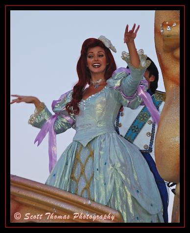 Princess Ariel waving to guests during the Make A Dream Come True parade in the Magic Kingdom, Walt Disney World, Orlando, Florida