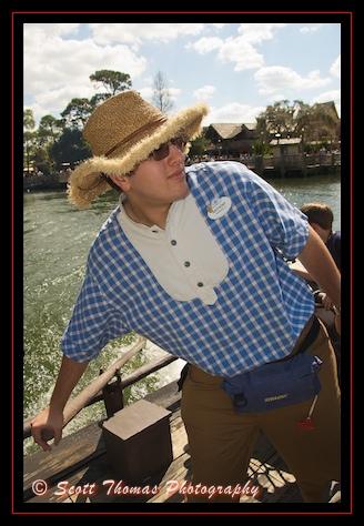 Cast Member Anthony pilots a raft from Tom Sawyer Island back to the Magic Kingdom, Walt Disney World, Orlando, Florida.