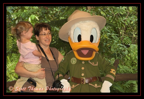 Ranger Donald Duck posing with guests at Camp Minnie-Mickey in Disney's Animal Kingdom, Walt Disney World, Orlando, Florida
