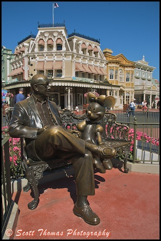 Minnie Mouse shares a park bench with Roy Disney in the Magic Kingdom, Walt Disney World, Orlando, Florida.